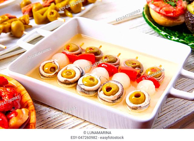 Olives anchovies and picked onion red pepper pinchos tapas from Spain
