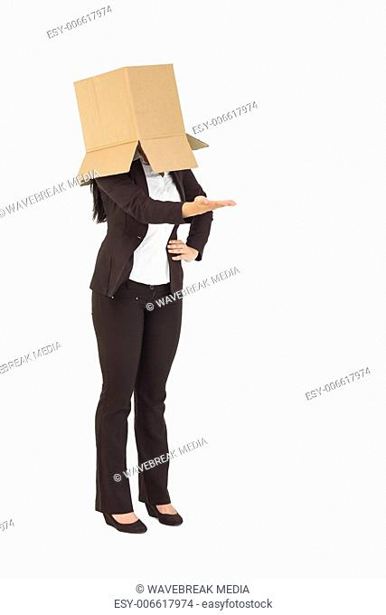 Businesswoman with box over head