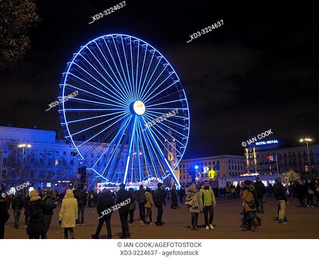 Ferris wheel in Place Bellecour at night, Lyon, Auvergne-Rhone-Alps, France