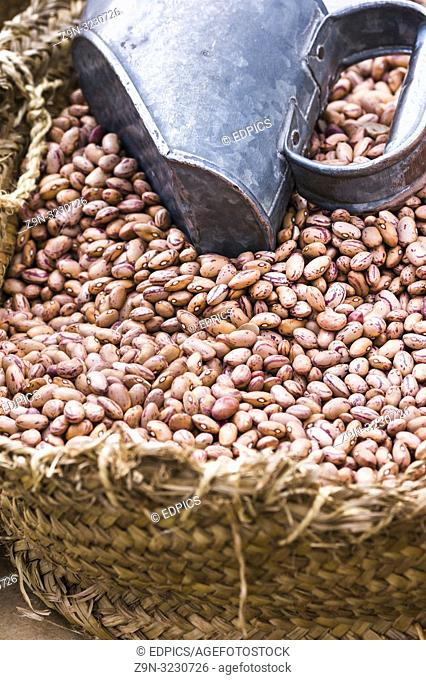 basket with common beans and measuring utensil at farmer's market, algarve region, portugal