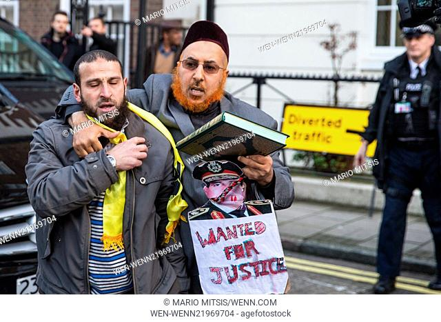 """Scuffles broke out when members of """"""""Britain First"""""""" disrupted a Muslim demonstration attended by Anjem Choudary outside the Egyptian Embassy"""