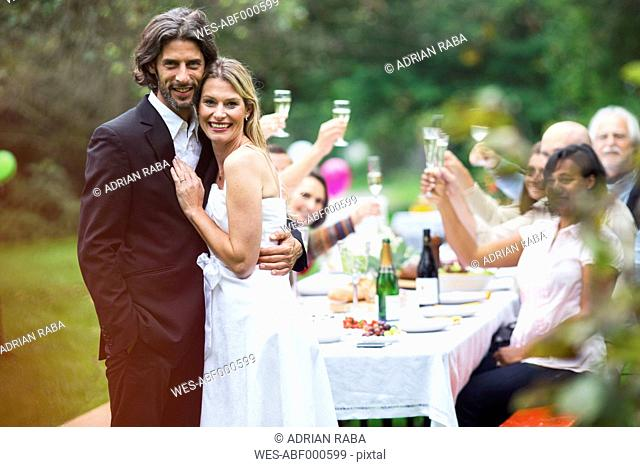 Bride and groom on a garden party
