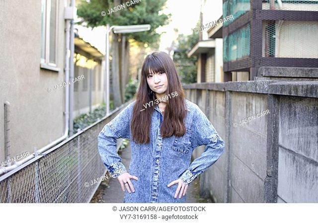 Japanese Girl poses on the street in Kichijoji, Japan. Kichijoji is a Tokyo's No. 1 city people want to live