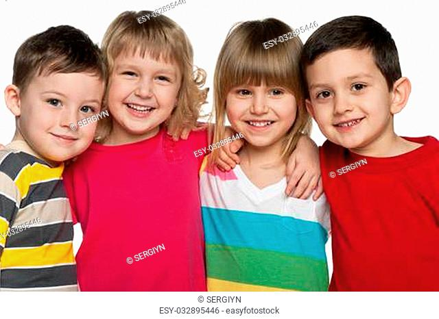 Four laughing kids are standing together; isolated on the white background