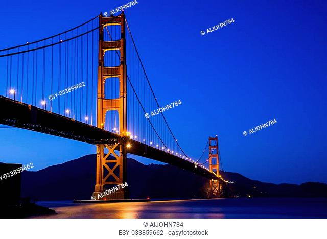 The Golden Gate Bridge at dusk as seen from Crissy Field in San Francisco