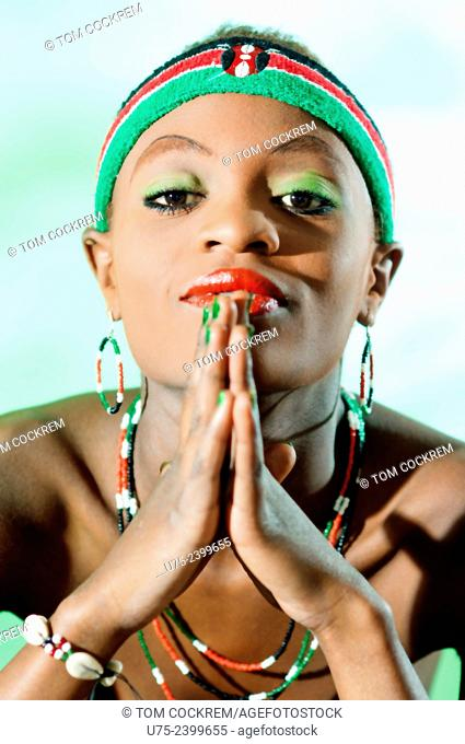 Young Kenyan woman in Kenyan National colors in studio setting