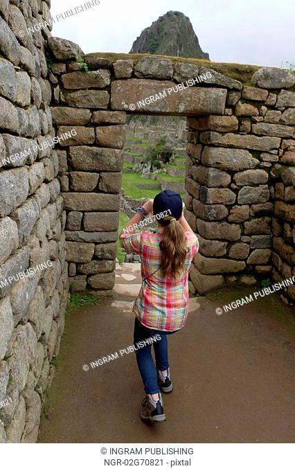 Girl photographing at The Lost City of The Incas, Machu Picchu, Cusco Region, Peru