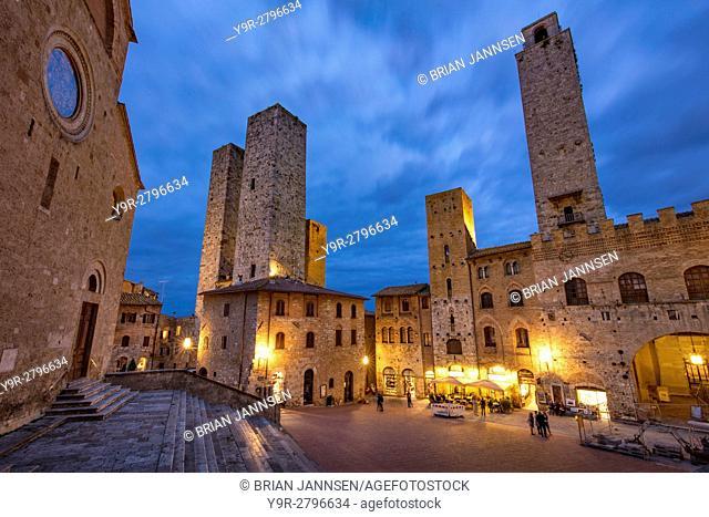 Piazza del Duomo and towers of San Gimignano at twilight, Tuscany, Italy