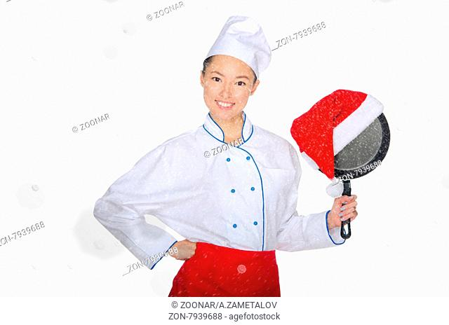 happy asian chef with frying pan and Christmas hat in falling snow