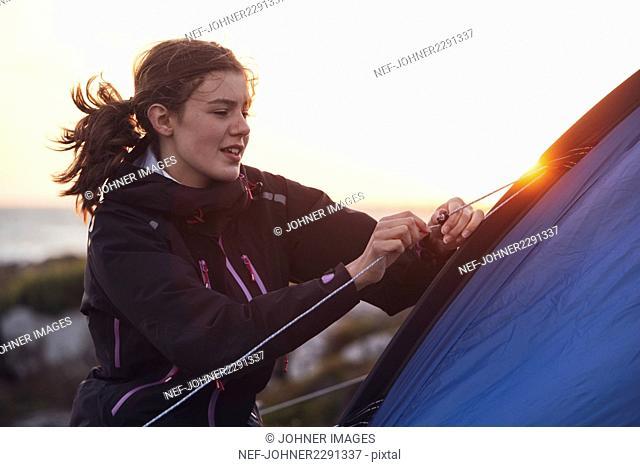 Woman near tent