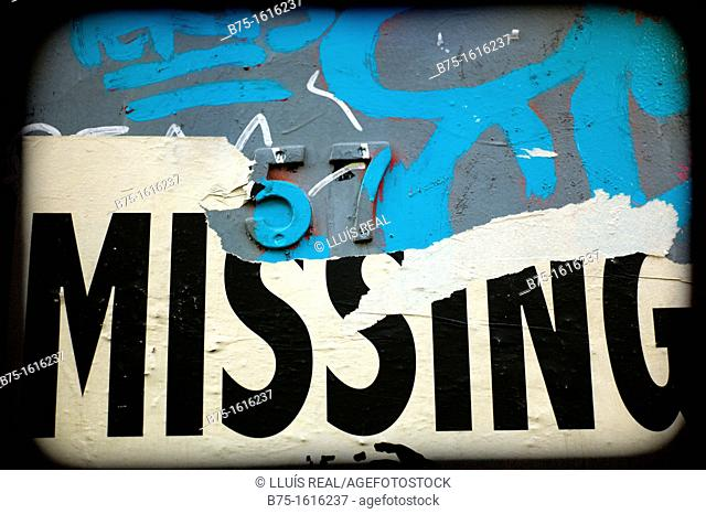 missing, graffiti in a door with number 57