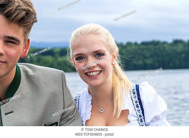 Germany, Bavaria, portrait of young woman besides her boyfriend