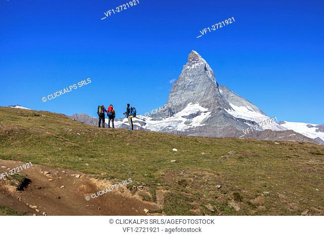 Hikers and photographers admire the Matterhorn in a clear summer day Gornergrat Canton of Valais Switzerland Europe