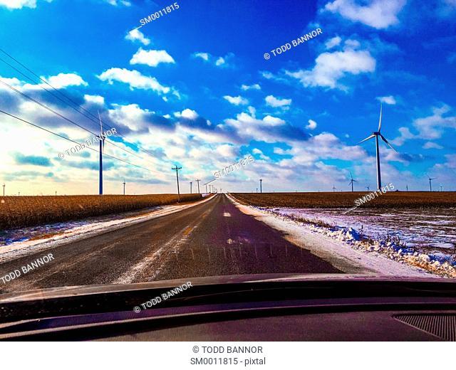 Driving rural highway through wind farm