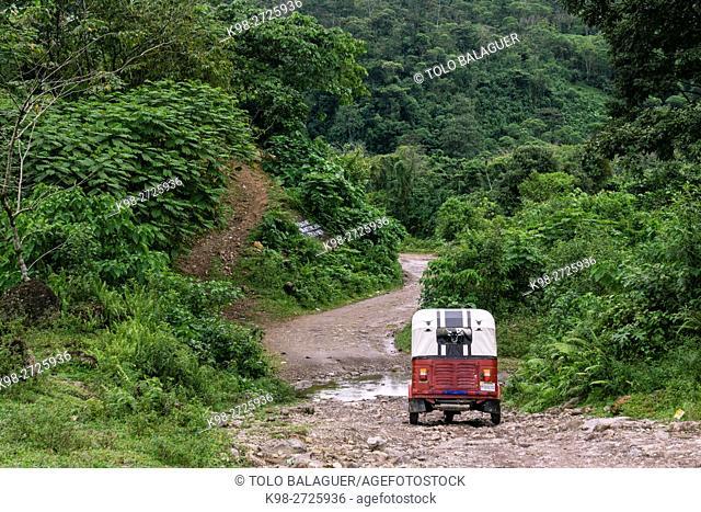 Tuc-tuc en el camino de La Taña a Union 31 Mayo, , zona Reyna, departamento de Uspantan,Guatemala, Central America
