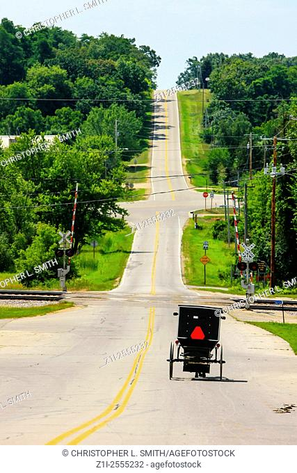 Amish horse and buggy on the road in a small rural community in Wisconsin