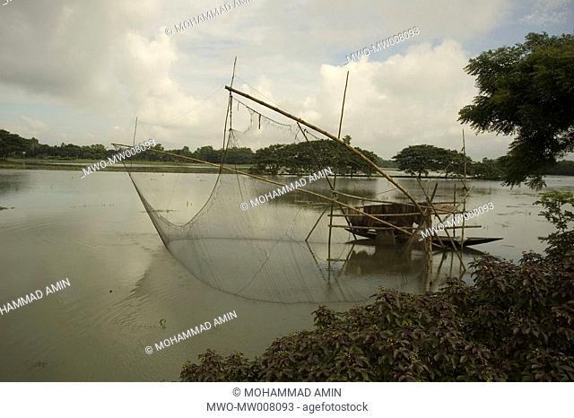 A fishing net in the river Kapasia, Gazipur, Bangladesh August 3, 2007