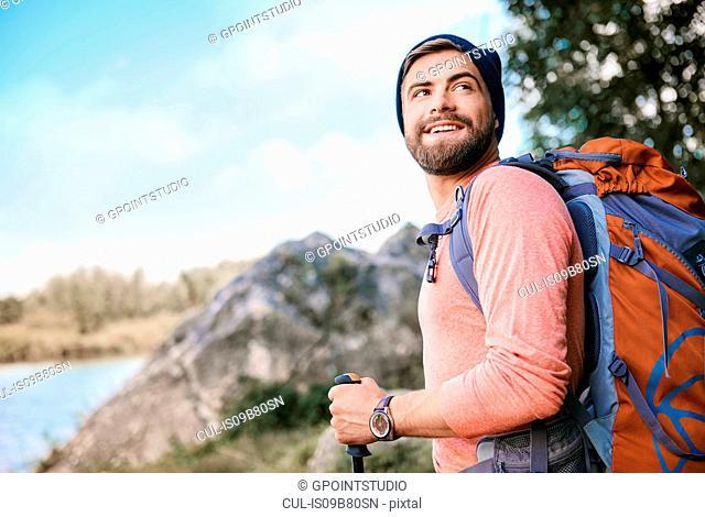 Portrait of man hiking, looking away smiling, Krakow, Malopolskie, Poland, Europe
