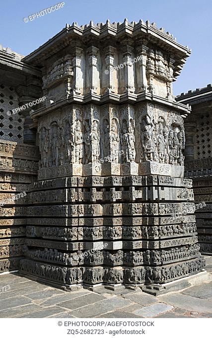 Ornate wall panel relief reflecting stellate form of shrine outer walls, Hoysaleshwara temple, Halebidu, Karnataka, india. View from South East