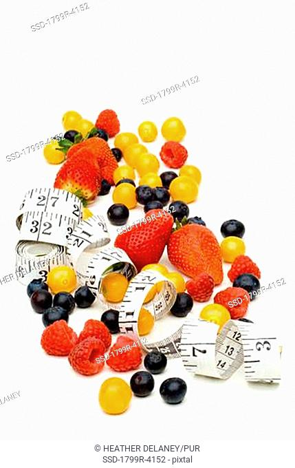High angle view of fruits with a measuring tape