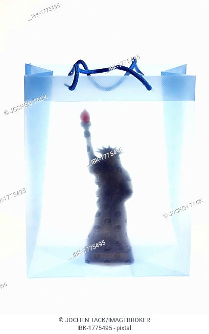 Clear plastic bag with a miniature Statue of Liberty