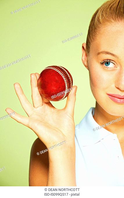 Young woman holding cricket ball