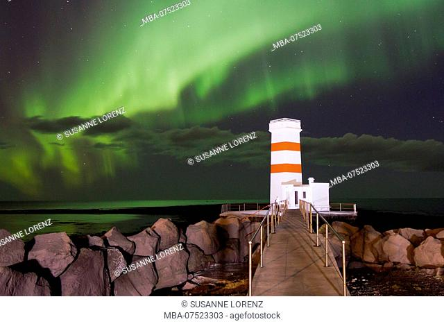 Spectacular aurora borealis above the lighthouse of Gardur, Iceland