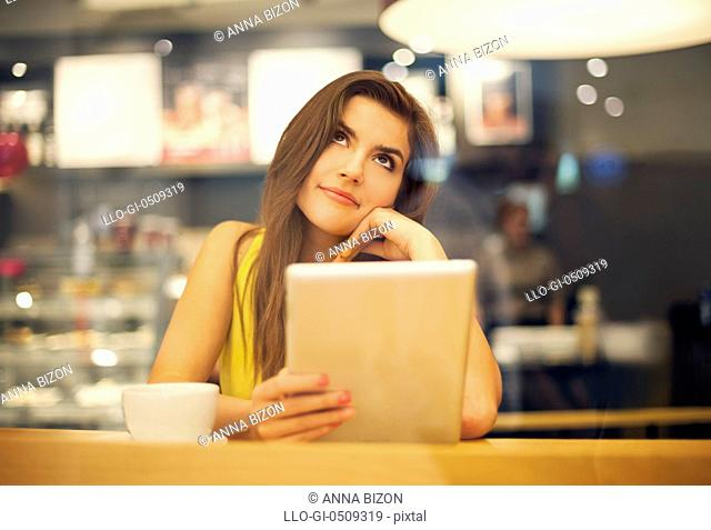 Young woman dreaming in cafe Debica, Poland
