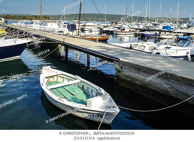 Boats moared in the commercial marina on the outskirts of Punat on the Croatian island of Krk