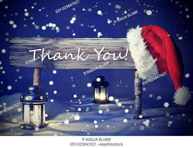 Vintage Wooden Christmas Sign And Santa Hat With White Snow. English Text Thank You For Seasons Greetings. Blue Silent Night With Snowflakes