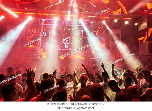party crowd cheering to DJ Quintino at music festival Starbeach on 31. July 2017, in Hersonissos, Crete, Greece