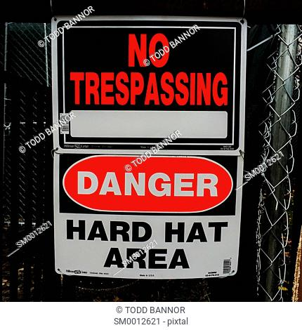 No trespassing hard hat area sign