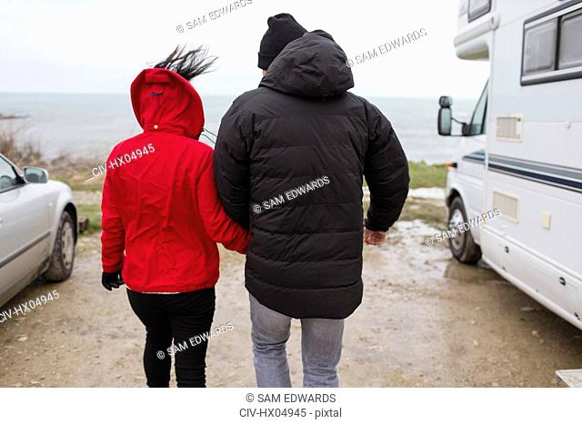 Couple walking outside motor home