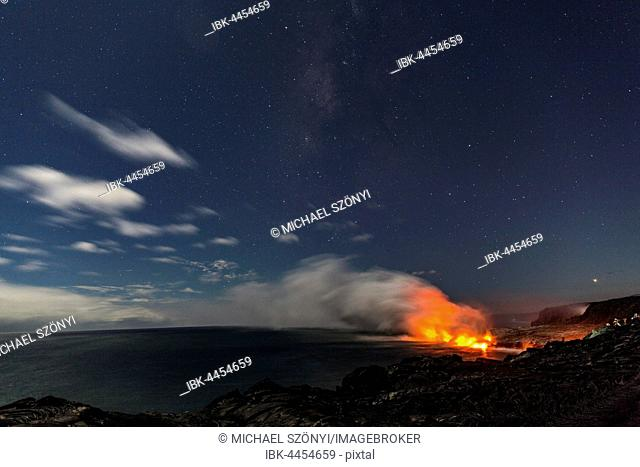 Lava entering ocean, night, Milky Way above, Kalapana, Hawai'i Volcanoes National Park, Big Island, Hawai'i, USA