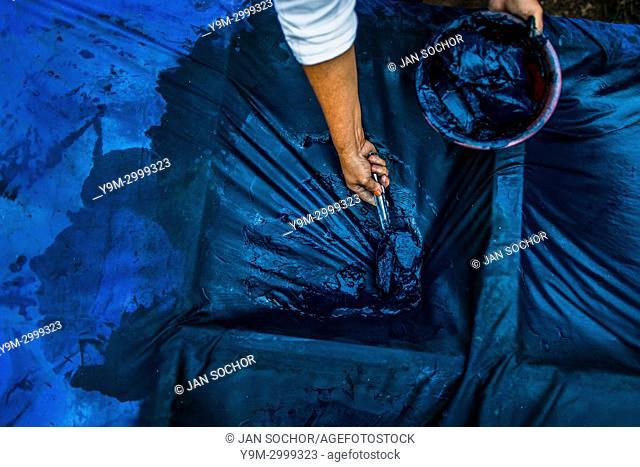 A Salvadoran farm worker collects indigo paste processed at the semi-industrial manufacture near San Miguel, El Salvador, 12 November 2016