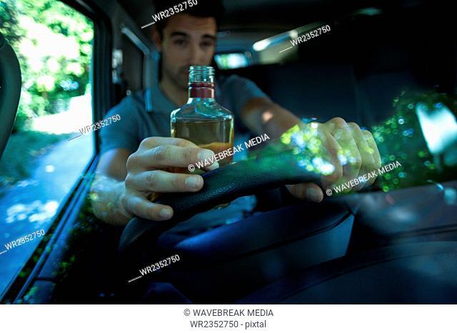 Drunk man drinking alcohol bottle