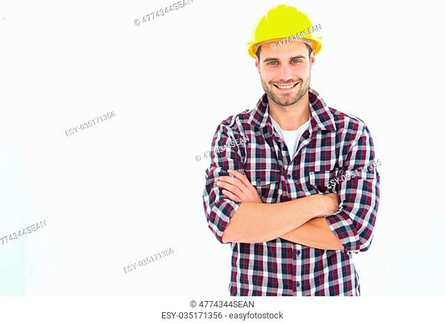 Portrait of handome male repairman standing arms crossed on white background