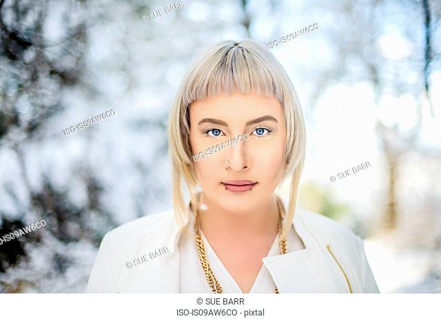Portrait of young woman against winter landscape