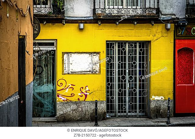 View of a yellow front in a central street of Madrid city, Spain