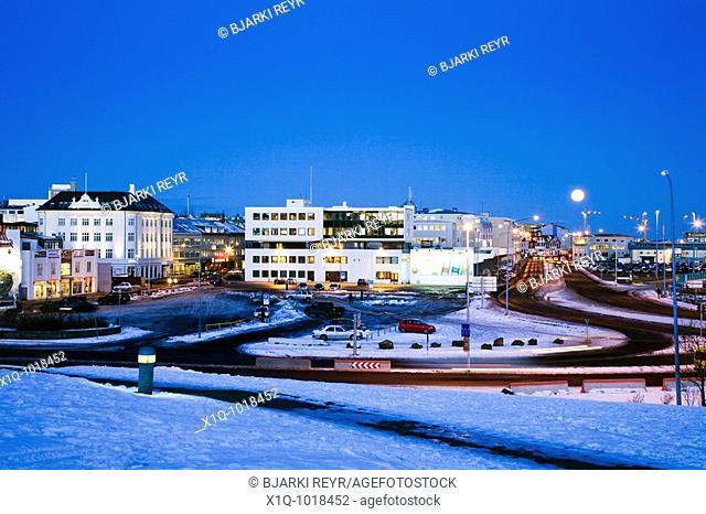 Full moon over Reykjavik on a cold winter morning. Downtown Reykjavík, Iceland