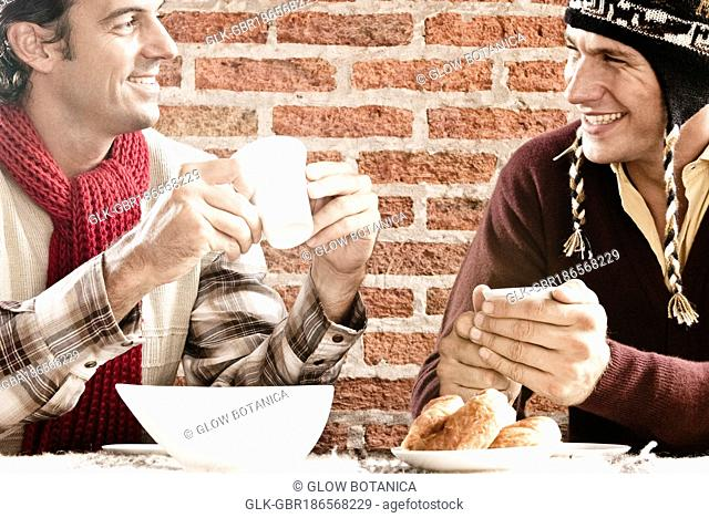 Two friends drinking coffee in a restaurant