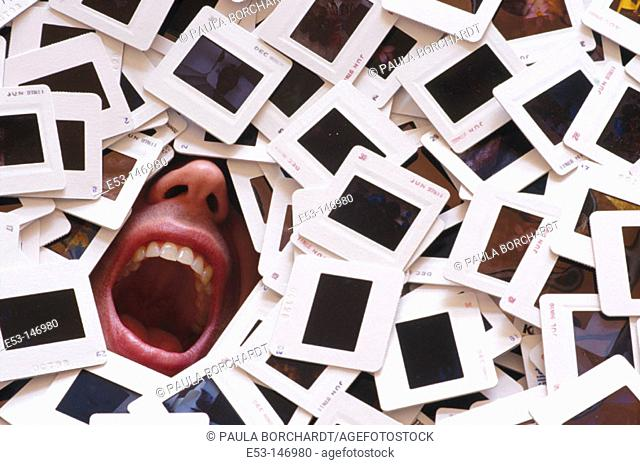 Man buried under a pile of 35 mm slides