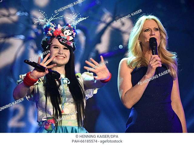 Singer Jamie-Lee Kriewitz (L) and host Barbara Schoeneberger react after winning the qualifying round for the Euro Vision Song Contest (ESC) in Cologne, Germany