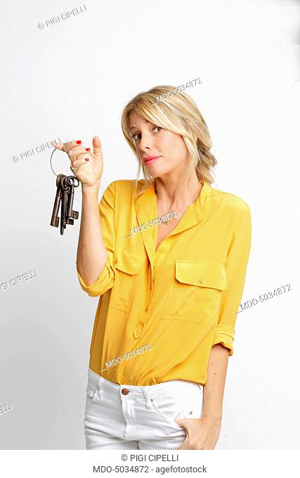 Alessia Marcuzzi, TV host of the reality show The Big Brother, season 14, holding a bunch of keys. Rome, Italy. 10th July 2015