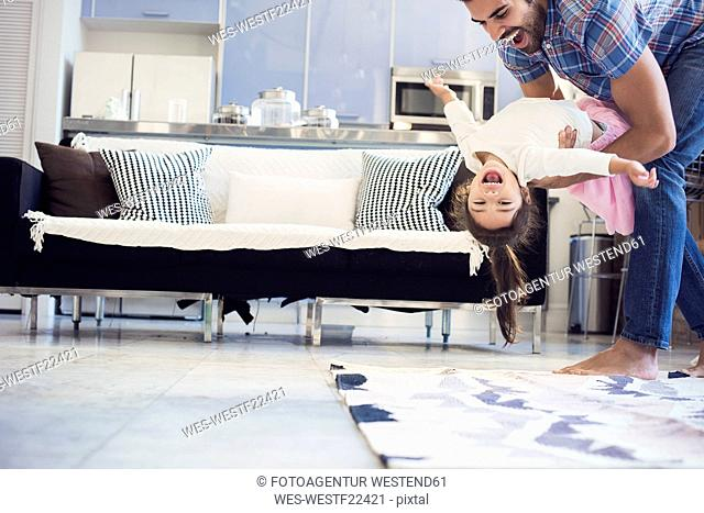 Father and daughter having fun at home