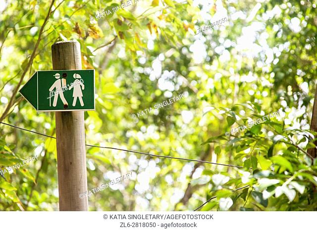 Sign for hiking trails on the beach in the tropical island of Martinique