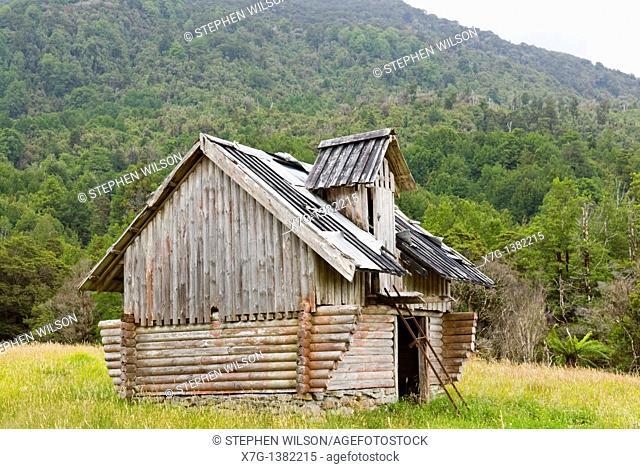 Derelict log cabin outside the historic township of Blackball, Souht ISland of New Zealand