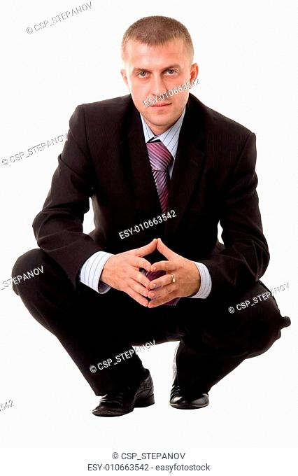 businessman sitting against white background