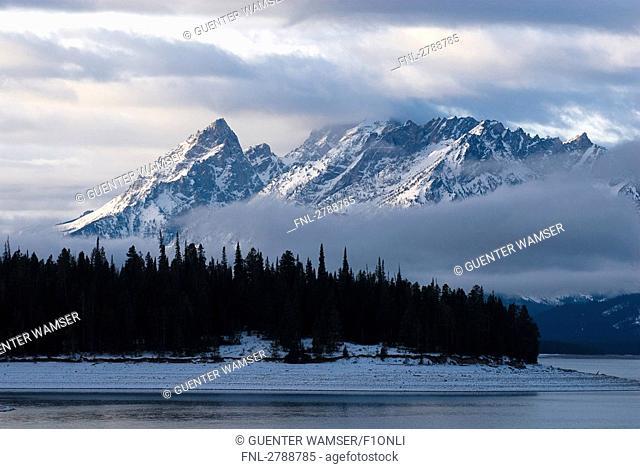 Lake with mountain in background, Grand Teton National Park, Wyoming, USA