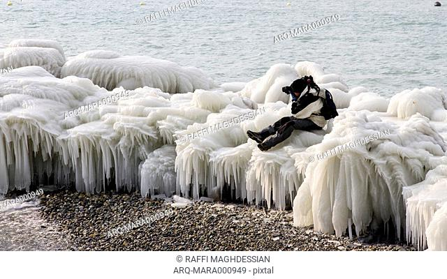 Person Taking Photograph Sitting On Top Of Ice In Lake Geneva Shoreline